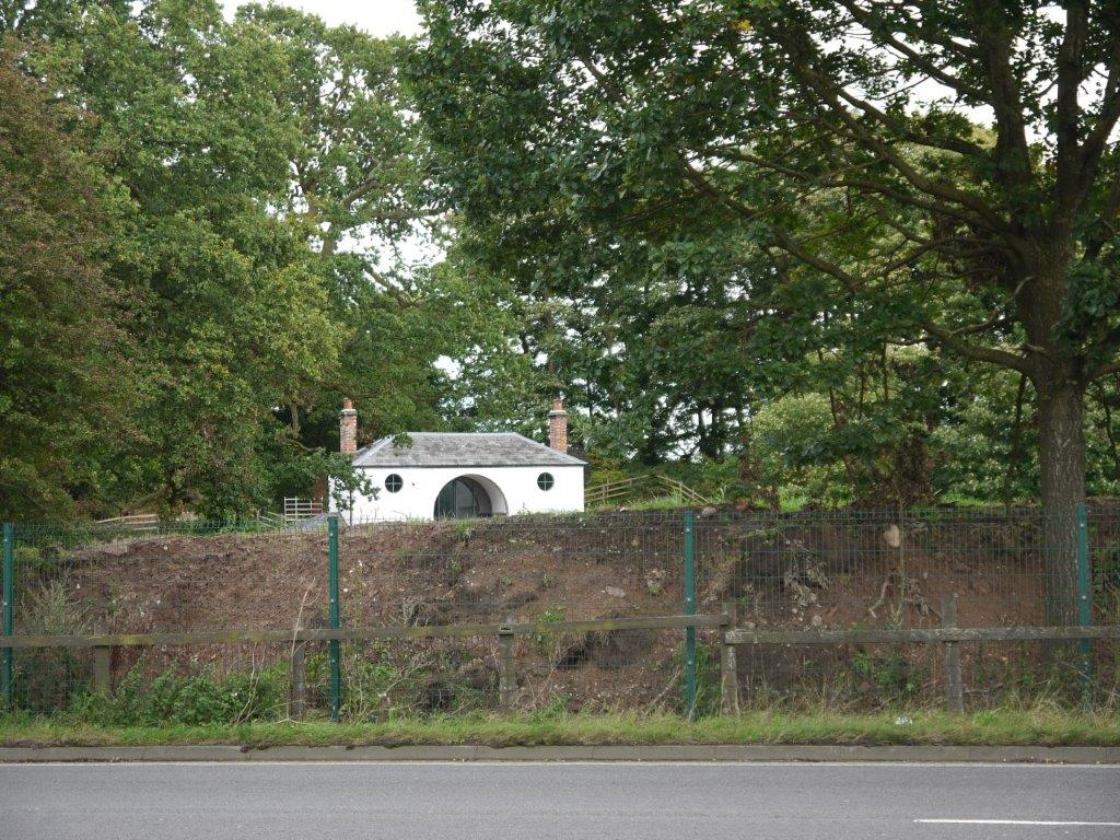 Tabley gate lodge showing earth mound