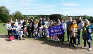 Group of families at Wicksteed Park with Heritage Lottery Fund banner