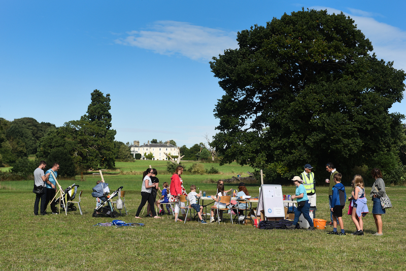 Families painting the landscape at Sharing Repton day at Catton Park