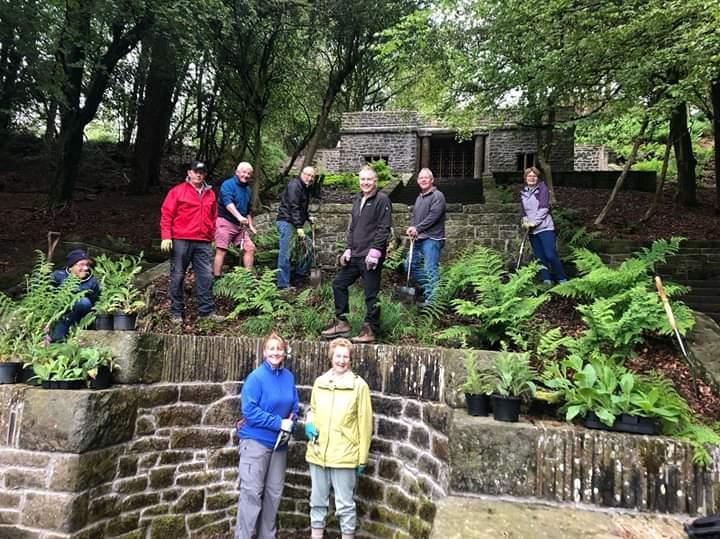 Volunteers planting foxgloves in Rivington Terrace Garden