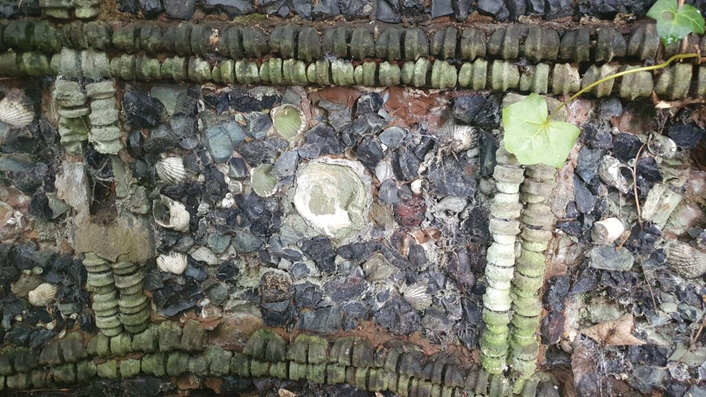 Detail of grotto showing oyster shell and animal bones